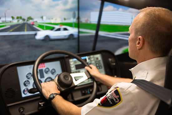 Fire chief driving emergency services simulator