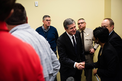 Governor Cooper shaking hands with Rowan-Cabarrus staff