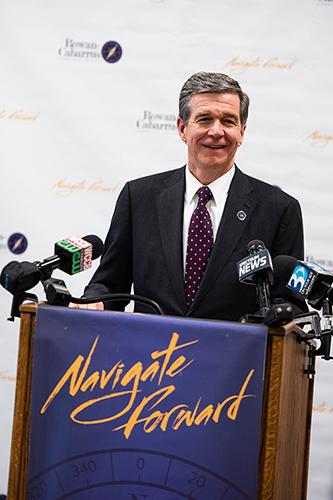 Governor Cooper at the podium