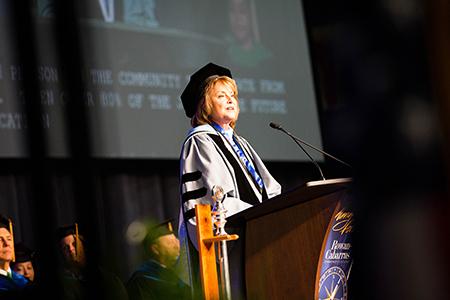 Dr. Spalding speaking at graduation