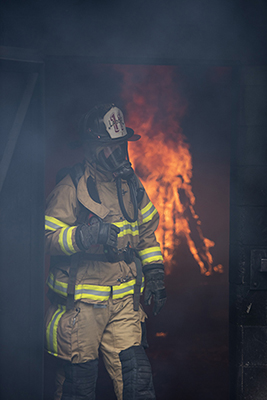 Fire student walking out of fire building