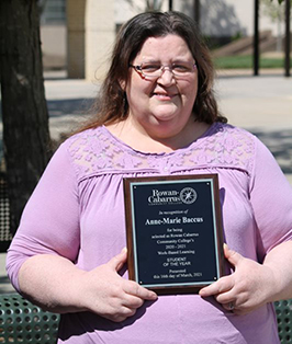 Anne-Marie Baccus holding award